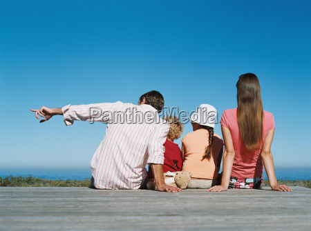 family looking at sea view
