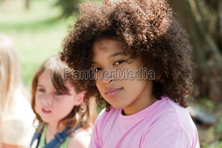 pensive girl looking at camera portrait