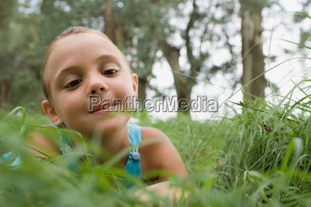 curious looking girl in a field