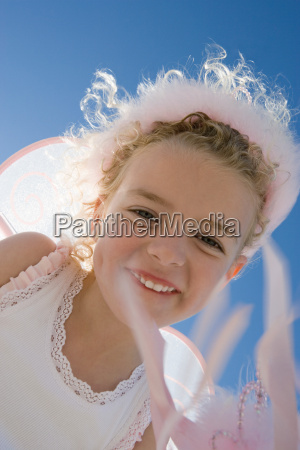 smiling girl with wings