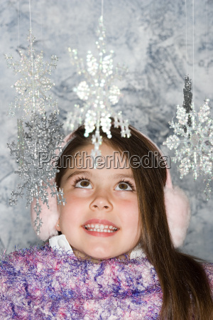 girl looking at snowflakes