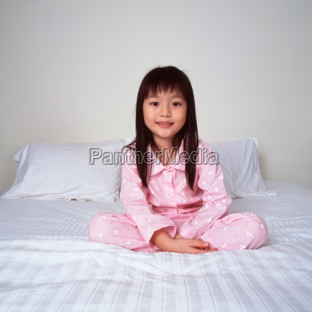 smiling young girl on bed