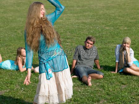 people watching woman dancing
