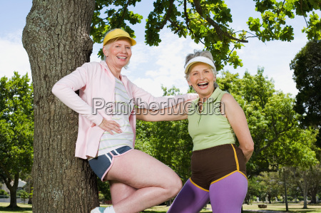 two senior adult women resting during