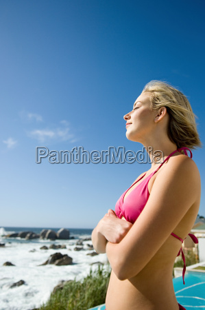 young woman standing in the sun