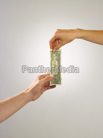 people holding banknote