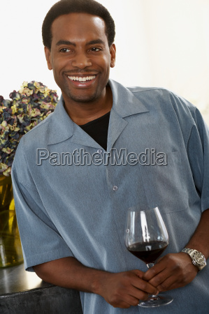 man with a glass of wine