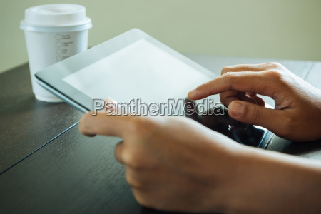 close up hand use tablet on