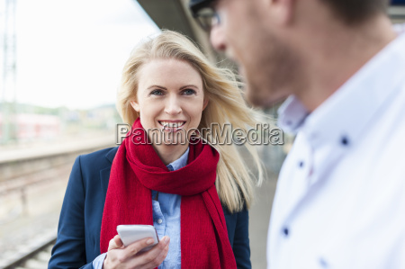 smiling woman with cell phone and