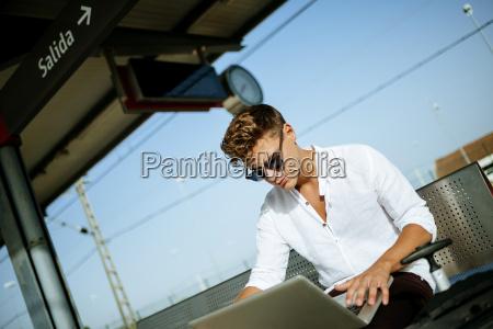 young man using a laptop at