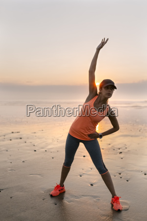 young athlete woman doing stretching on
