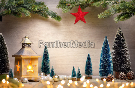 christmas arrangement with lantern trees tree