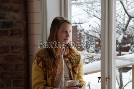 woman next to window snow outside