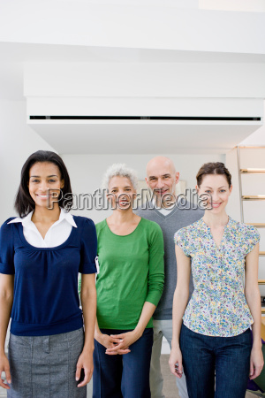 4 business people looking at viewer