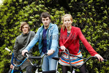 teenagers with bicycles in park