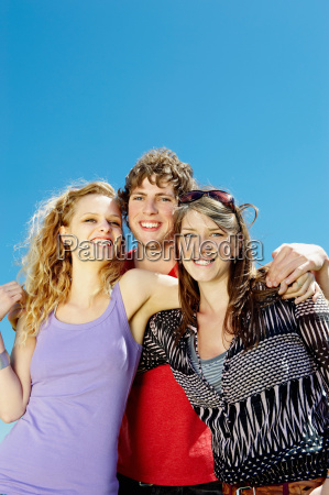 portrait of three young happy people