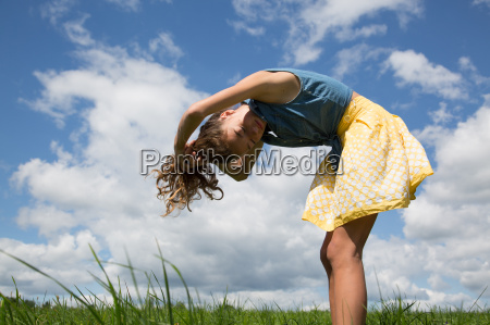 teenage girl bending forward with hands