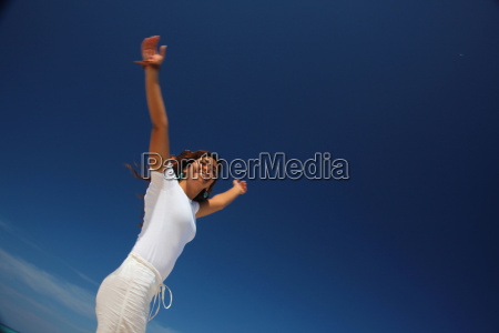 young woman jumping on beach paradise