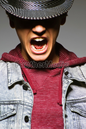 young man wearing hat and shouting