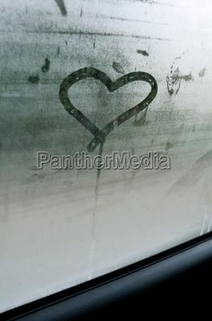heart shape on car window