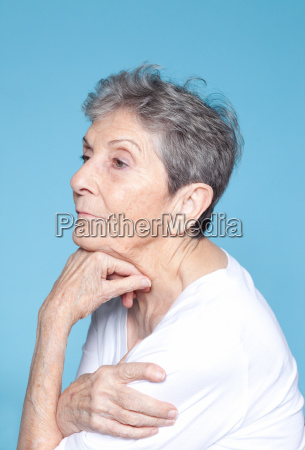 senior woman looking away with hand