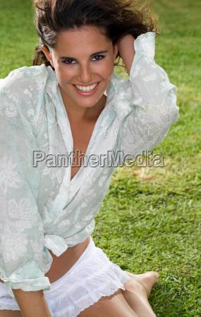 happy woman portrait in grass
