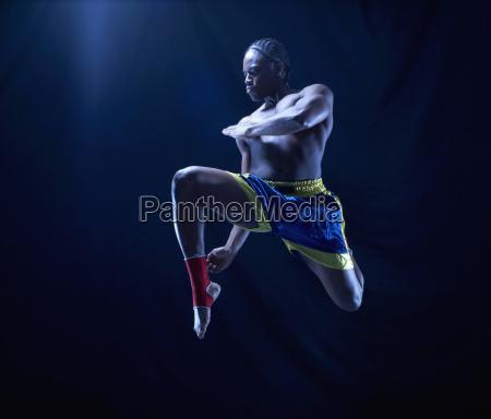studio shot of kick boxer mid