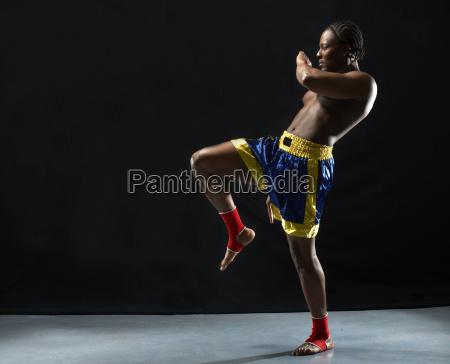 studio shot of kick boxer