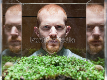 man observing green plant