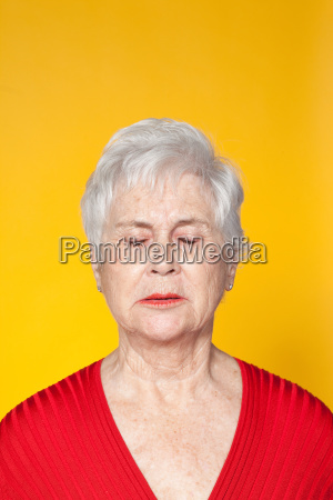 senior woman with eyes closed studio