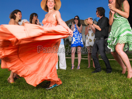 group of people dancing outside