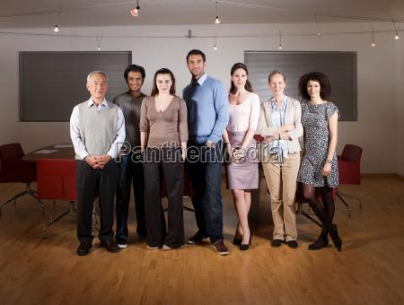 group portrait of people in boardroom