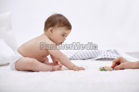 mother and baby daughter playing baby