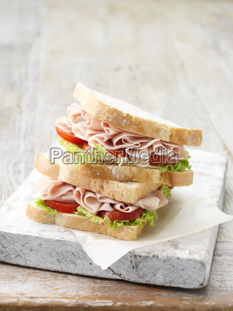stack of wafer thin ham sandwiches