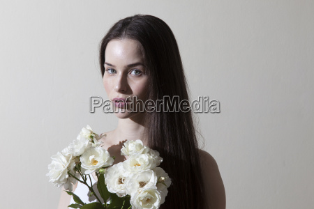 portrait of young woman holding white