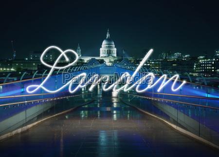 glowing handwritten london in front of