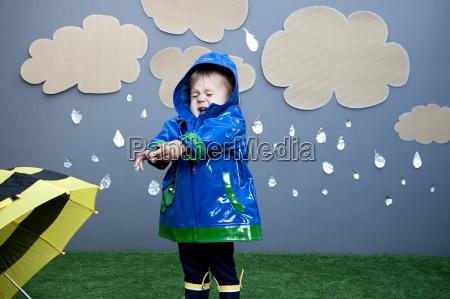 baby girl with rain cutouts