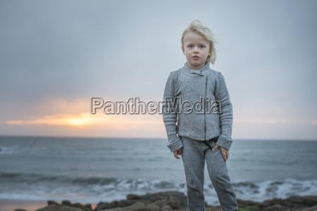 portrait of boy on breezy coast