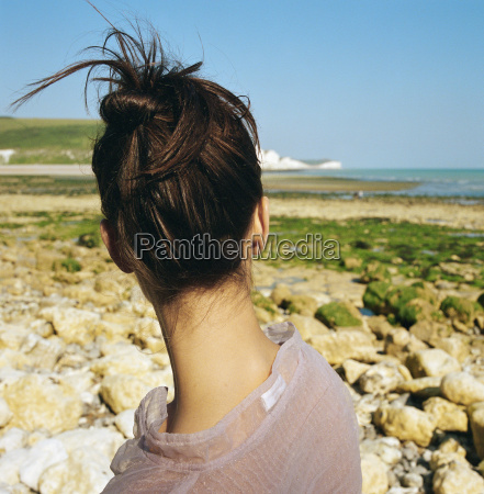 woman looking away towards the sea