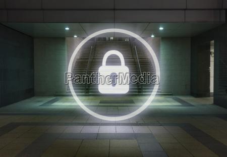 glowing padlock symbol in office building