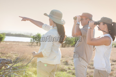 people using binoculars on a safari
