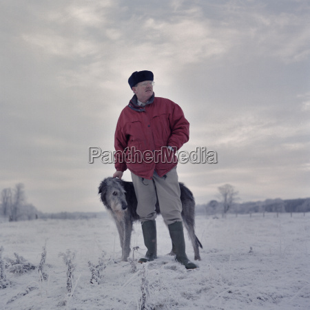 portrait of man with deerhound in