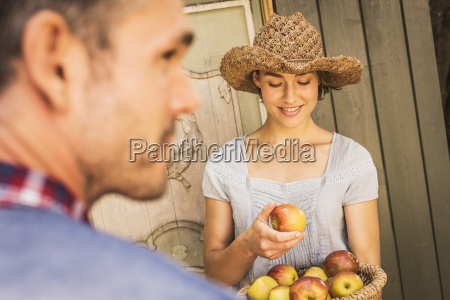 young woman wearing straw hat holding