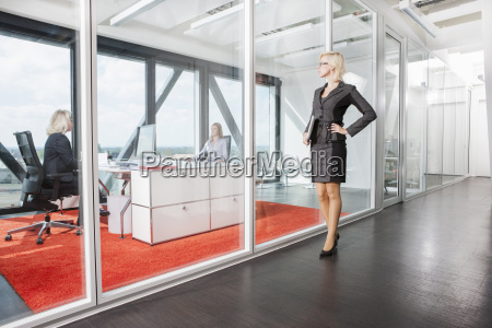 mid adult woman standing outside interview