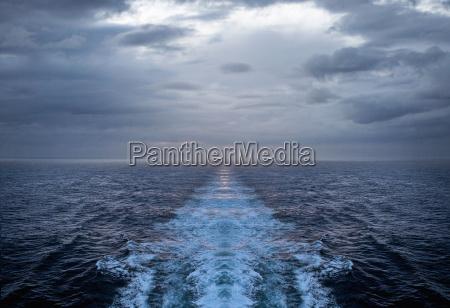 churning water trail in ocean