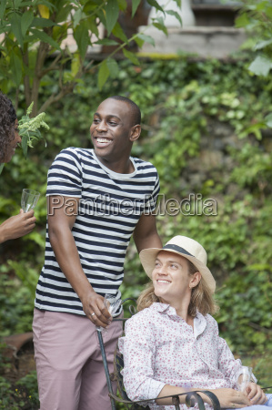 two male friends enjoying garden party