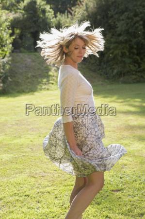 woman dancing at garden party