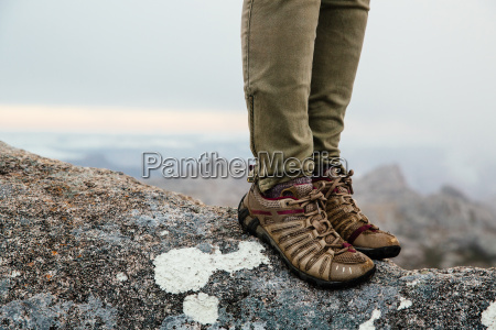 mid adult woman standing on mountain