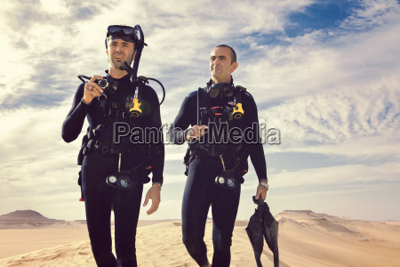 two men in wetsuits great sand