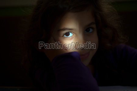 girl looking at camera from darkness